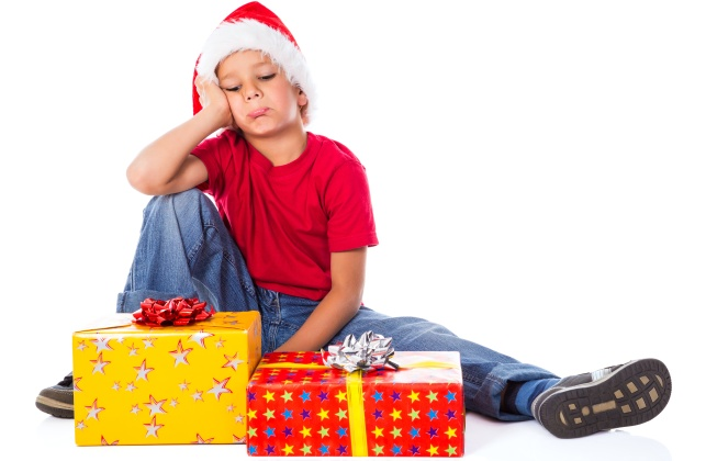 Sad boy with gift box in christmas hat